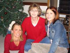 Christmas '04..Im in the red, with my sister and mom..Go