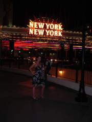 "Posing in front of our hotel ""New York, New York"""