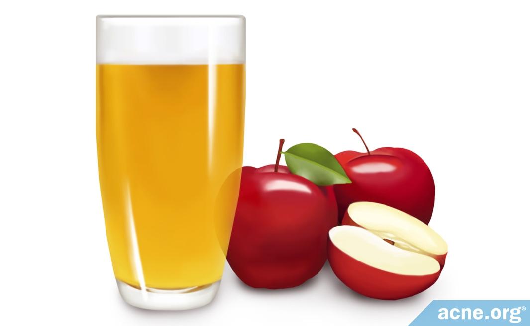 Apples Next to Apple Cider Vinegar in Glass